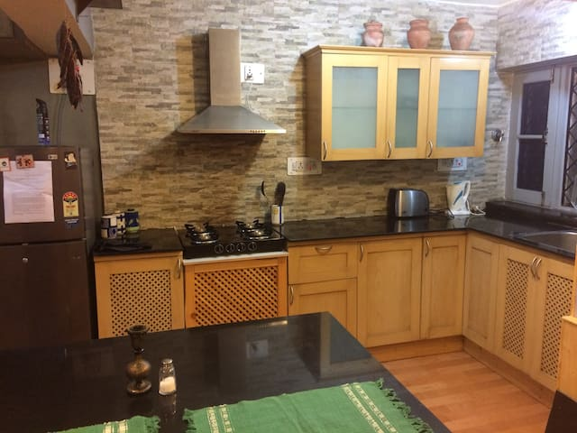A modern kitchen with all essential amenities.