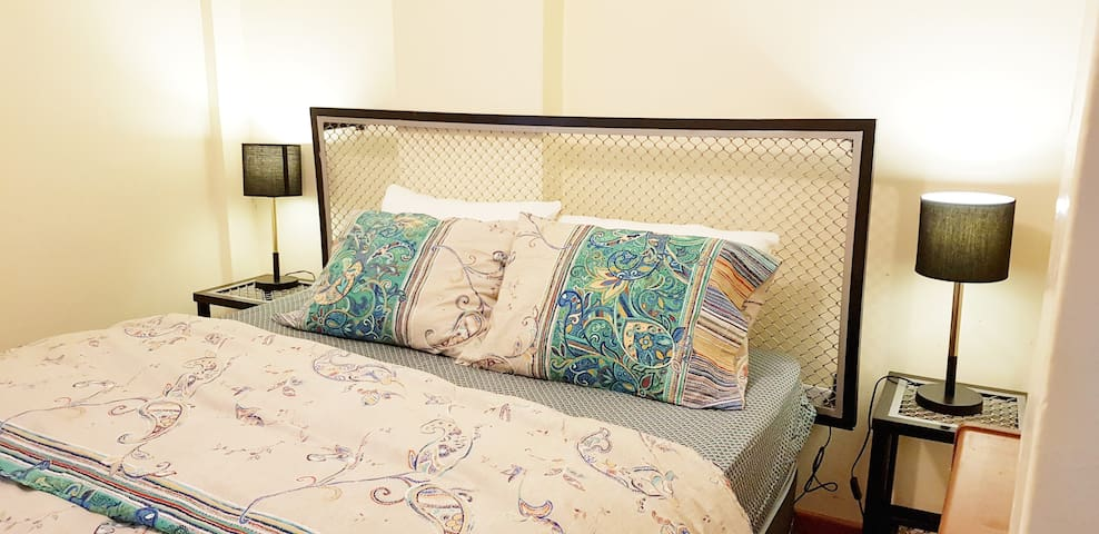 View of I° bedroom  with queen bed..