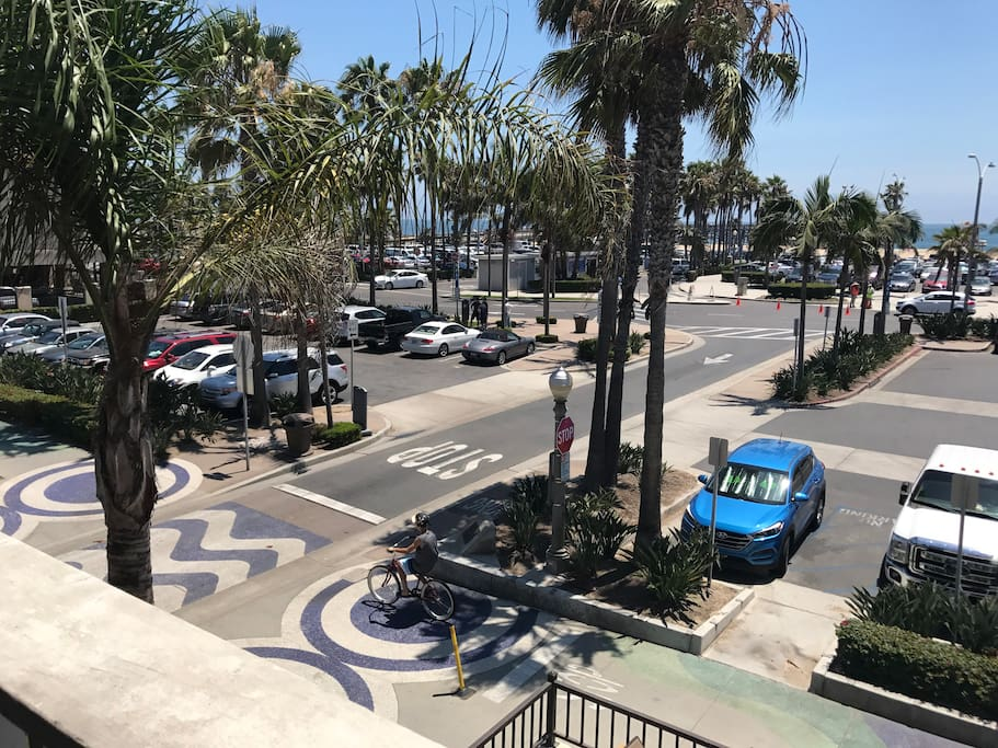 View from patio & family room - shops, restaurants, cafes and bike rentals are all just steps away. Boardwalk is directly below.
