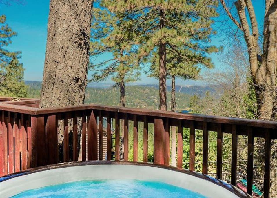 Take a dip in the spa and enjoy views of Lake Gregory.