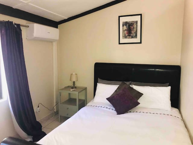 Main bedroom with comfy queen sized bed- Air conditioned