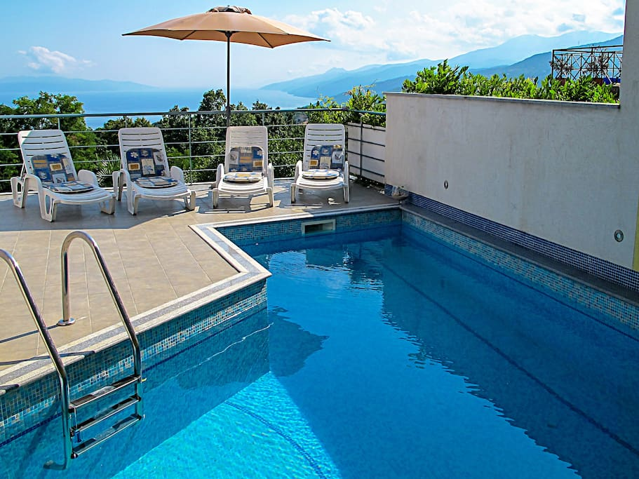 Pool side with stuning view of Kvarner Bay and surrounding mountains