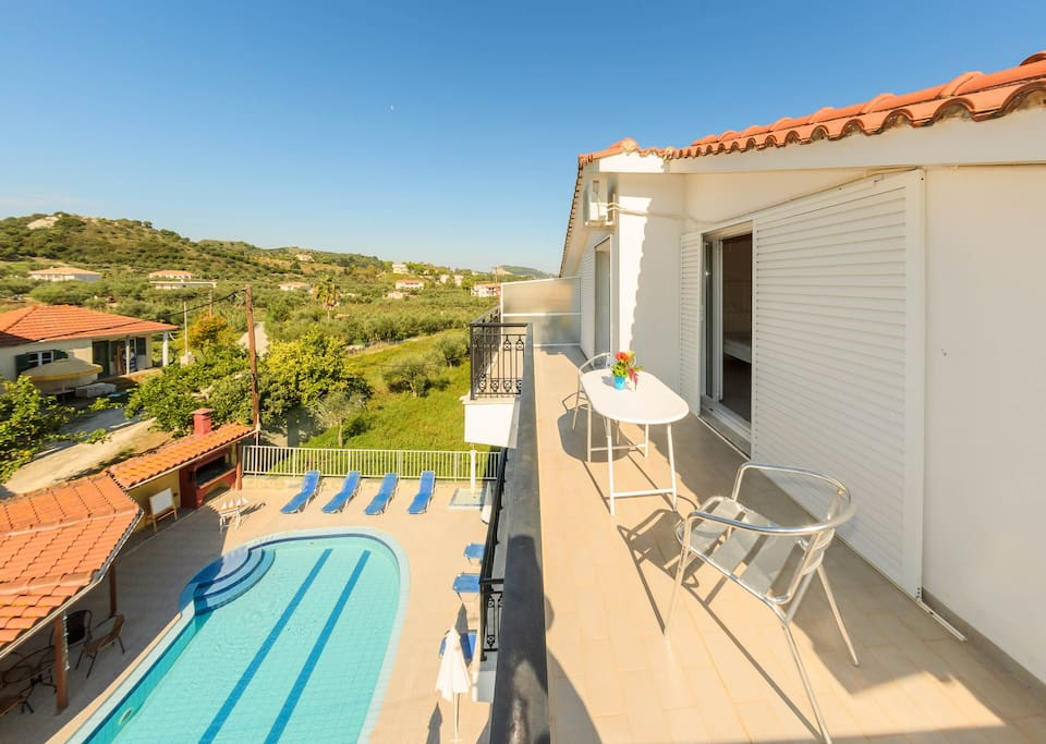 Furnished balcony with surroundings & pool view