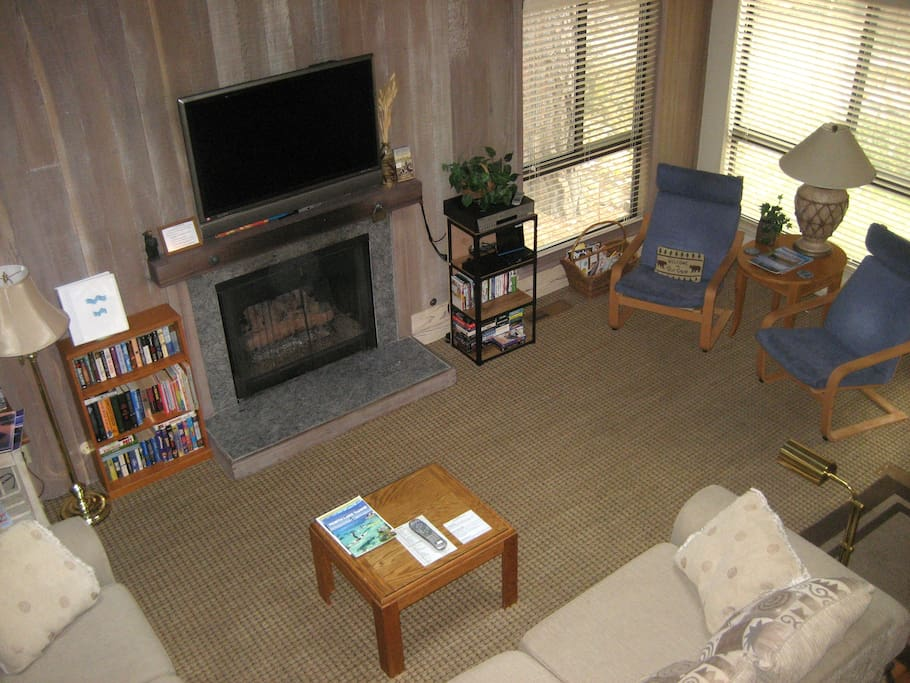 Large flat screen over fireplace.