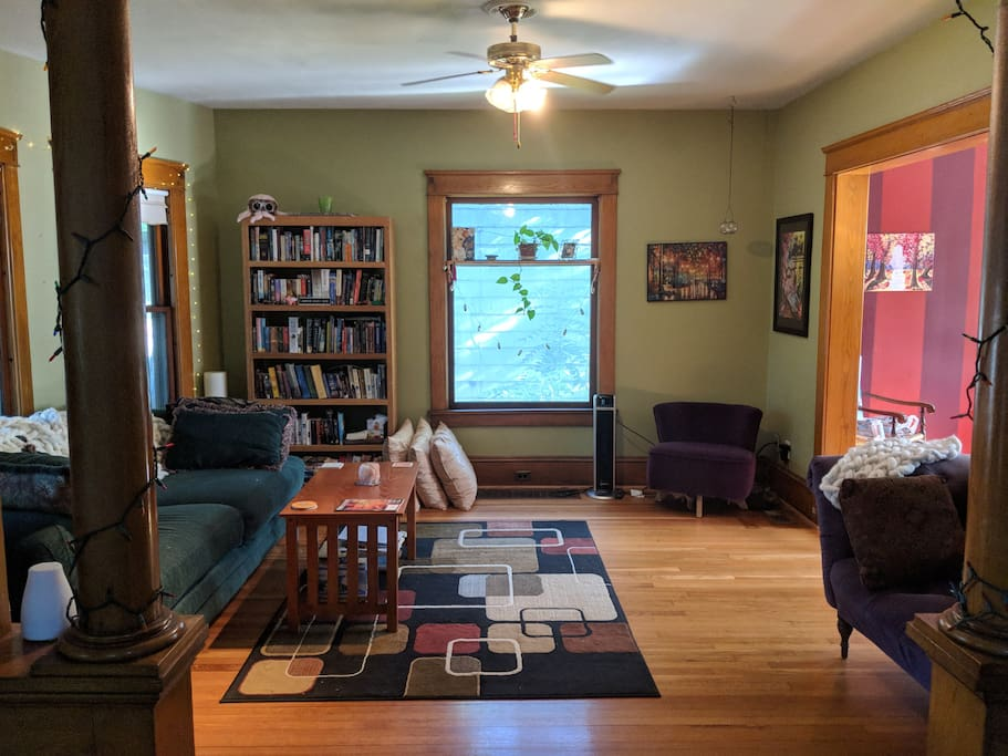 Plenty of couch and chair space for lounging, and a lending library you're welcome to use while you're here!