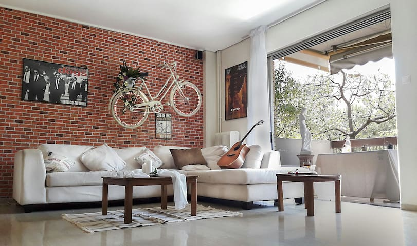 "THE FAMOUS ""BIKE ON THE WALL"" APT IN ATHENS 100sqm"