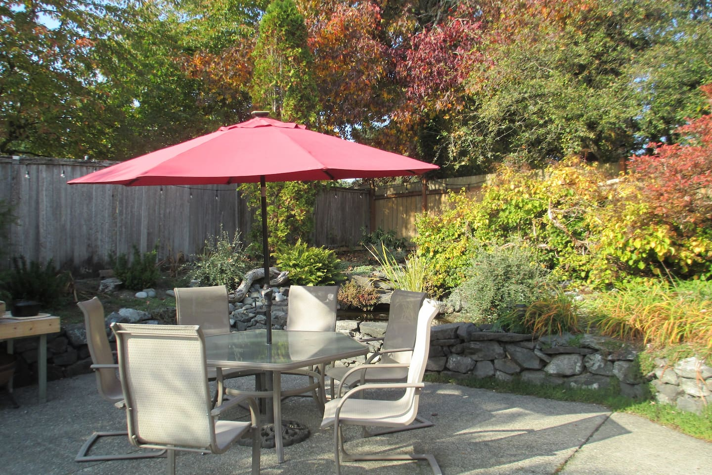 Garden patio with fish pond