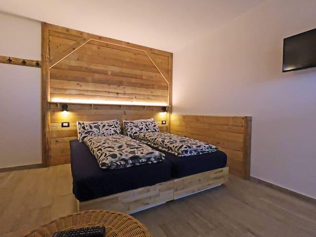 Deliziosa camera privata indipendente in Chalet