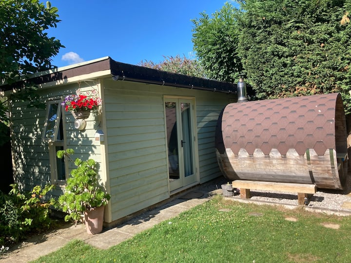 Garden holiday cabin with use of barrel sauna