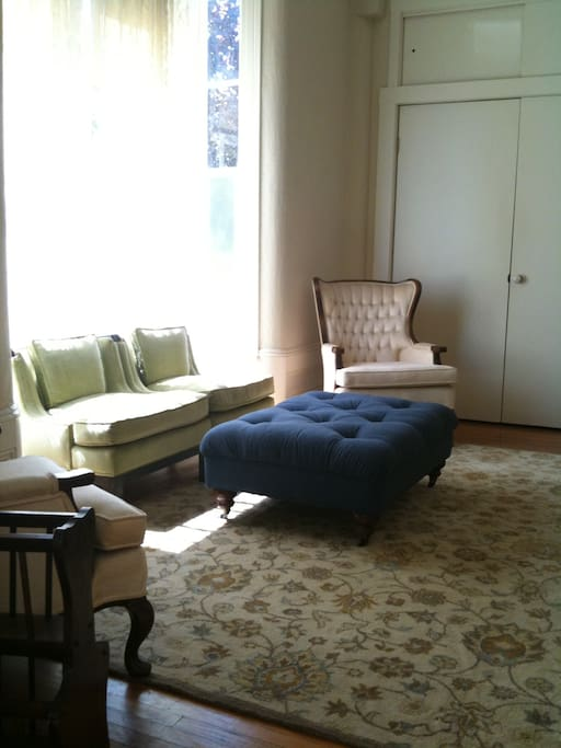 Main parlor has comfortable seating and flat screen TV.