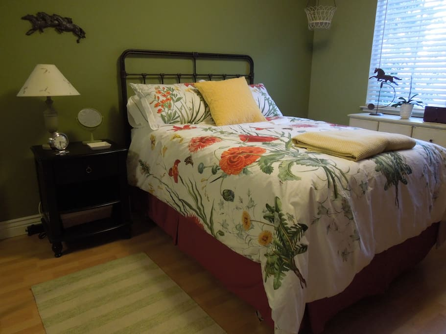 Cheery front bedroom features double bed, large closet and dresser.