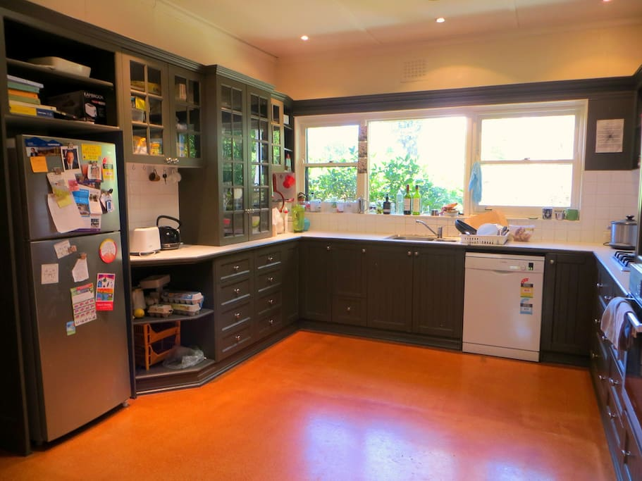 We have a nice kitchen that overlooks a big backyard.