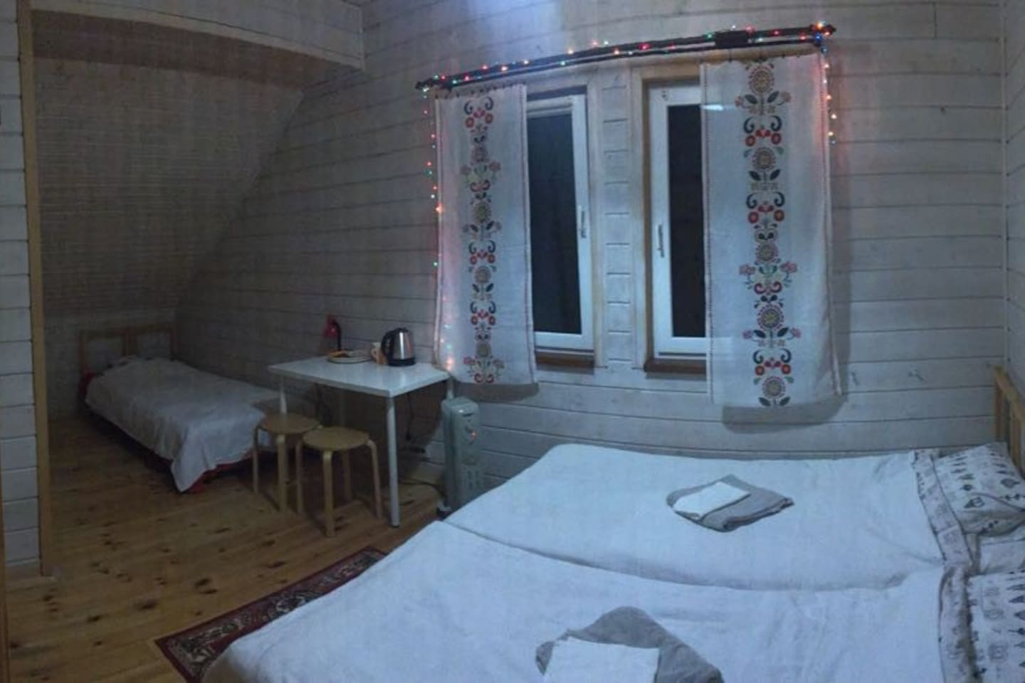 room set up for couple + an extra bed