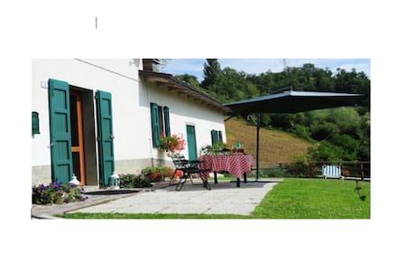 Ca Badiali casale di campagna in appennino - Olina - Blockhütte