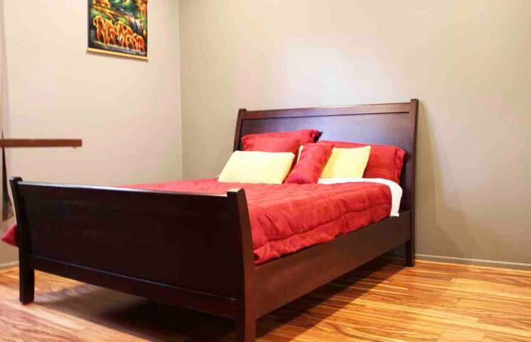 Comfy Queen bed in the second bedroom.