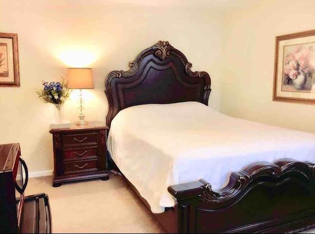 Comfortable queen bed with in-suite bath