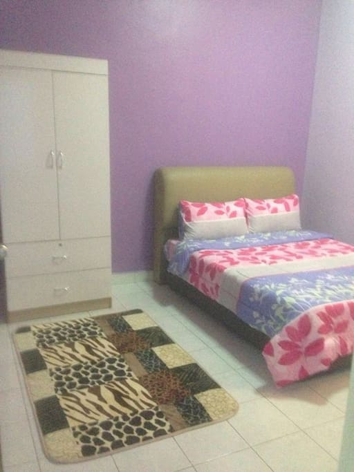 Master bedroom - comes with a queen bed, a wardrobe, a bathroom and air-conditioned