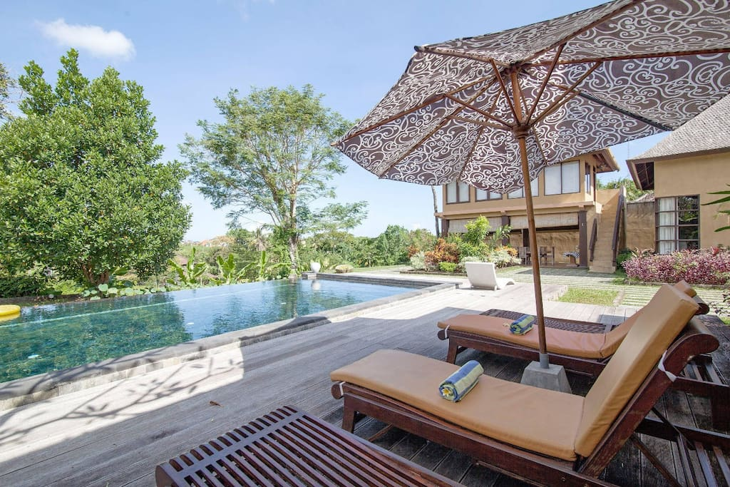 The sun lounges by the main pool
