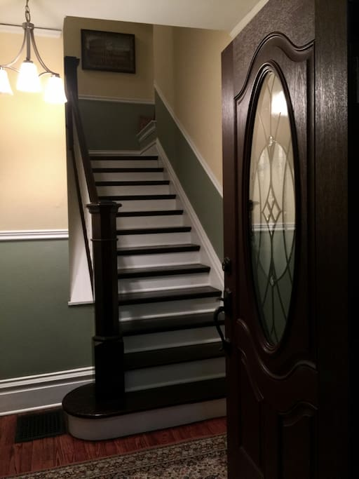 Main entrance, and stairs that lead to Guest Room.