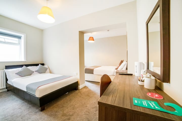 Standard Quad Room in OYO Tequila and Dunlin Rooms