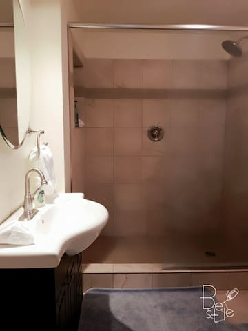 new modern and recently renovated bathroom with large walk in shower