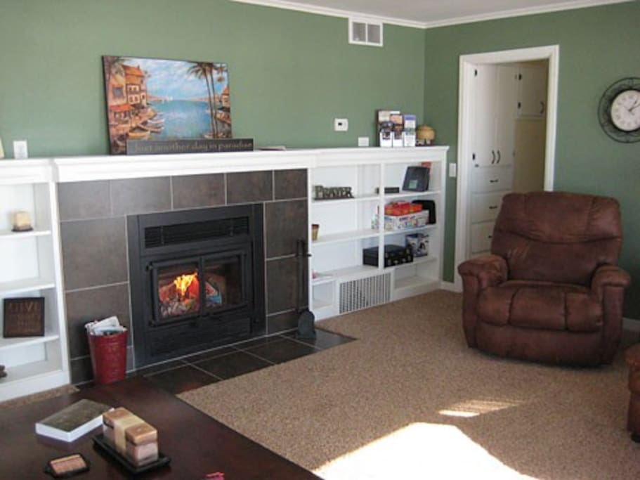 Great room has wood burning fireplace