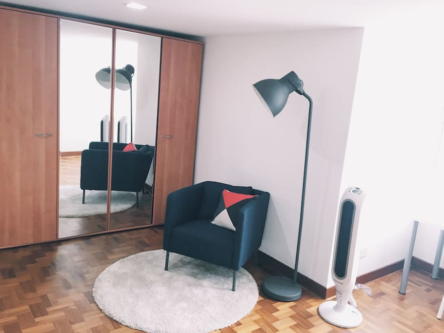 L1 - Wardrobe, and comfortable armchair under modern lamp