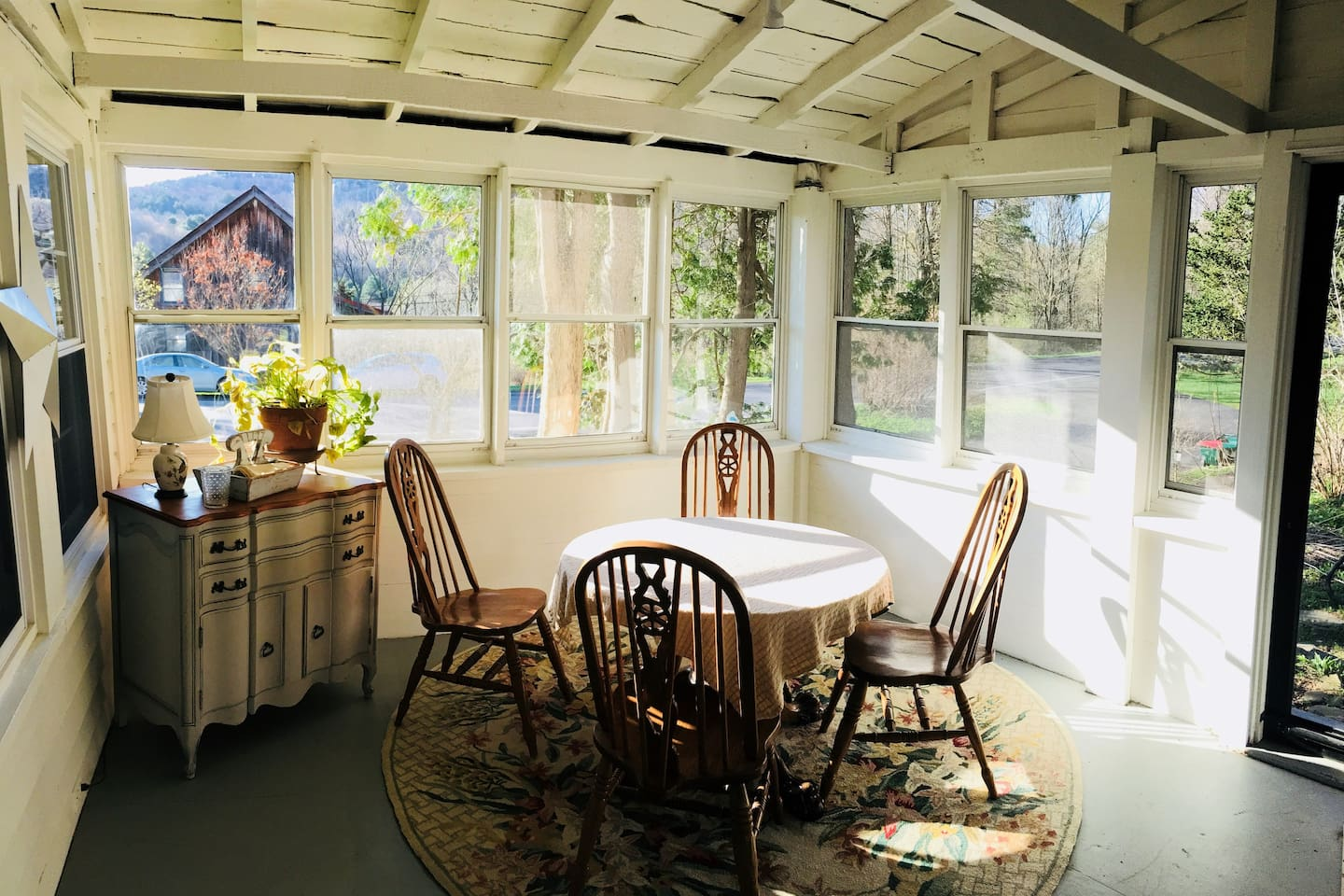 Cozy dining area on glassed in sun porch!
