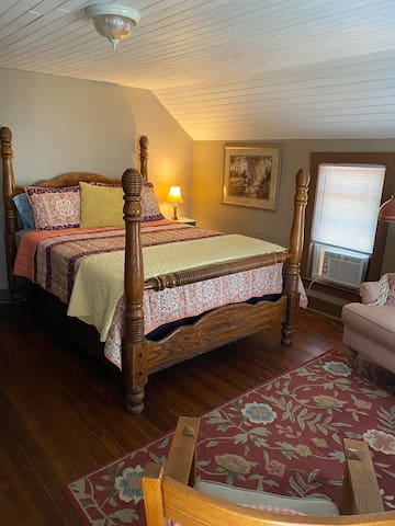 Room #3. Upstairs north room. Queen size bed.