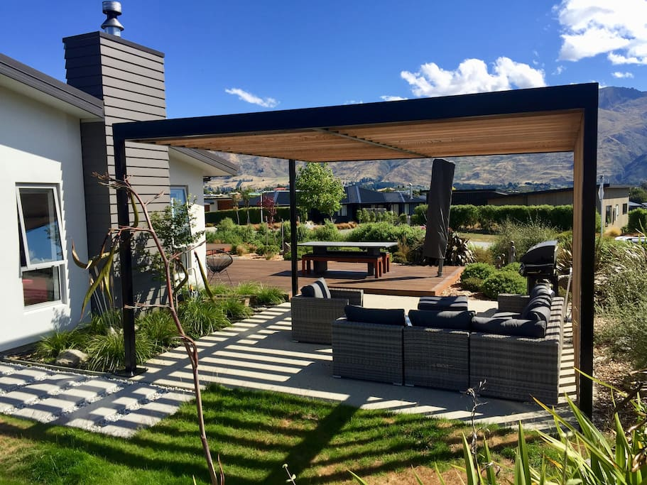 Outdoor lounge space under shade of pergola