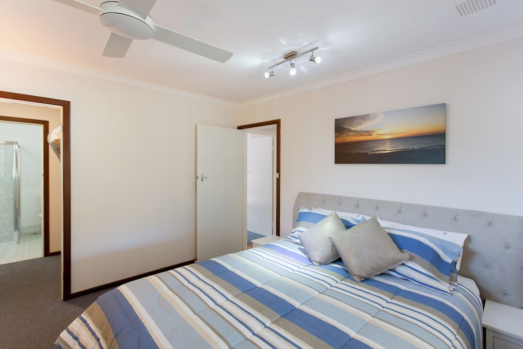 Main bedroom with ensuite and walk in robe. Overlooks back garden with two sets of windows for beautiful ocean breeze.