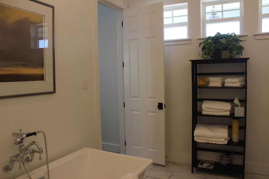 En suite bath includes six foot free standing soaking tub.