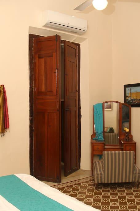 Lovely antique vanity in master bedroom