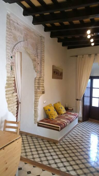 The living room with its ancient arc, cooling floor tiles and possible extra bed
