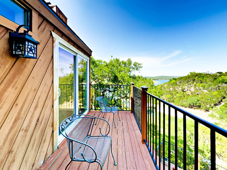 The balcony offers sweeping views and seating for 2.