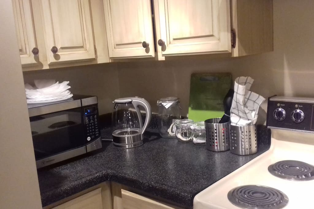 A few basic kitchen appliances like a microwave, electric hot water kettle, and keurig coffee maker.