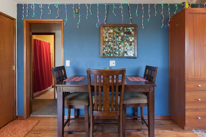 The kitchen table has loads of light, it's one of many work areas you are welcome to use.