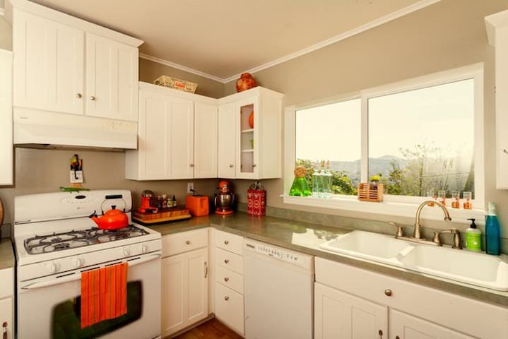 fully stocked kitchen w/ plenty of cookware, dishes, glasses and spices