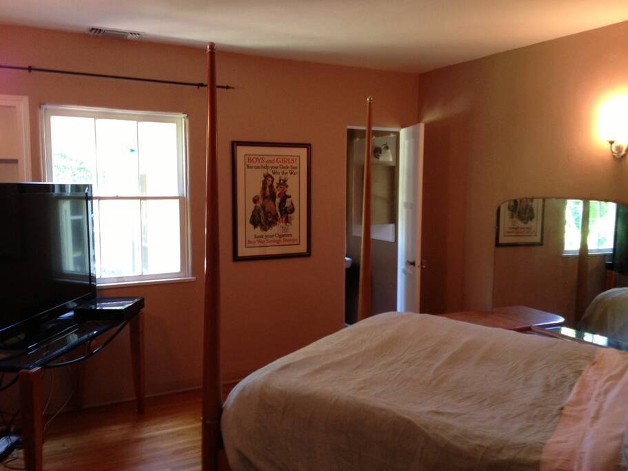 This the guest bedroom with its own big screen tv and bathroom.