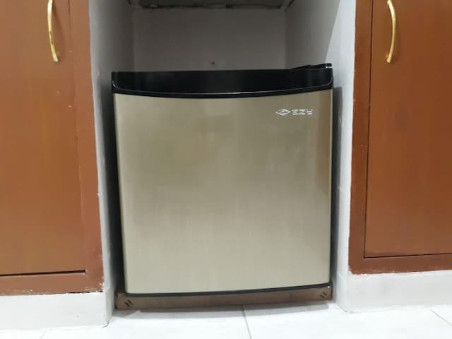 The mini refrigerator.