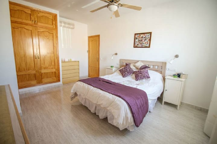 Master bedroom with king-size bed and two built in wardrobes.  Air conditioned.