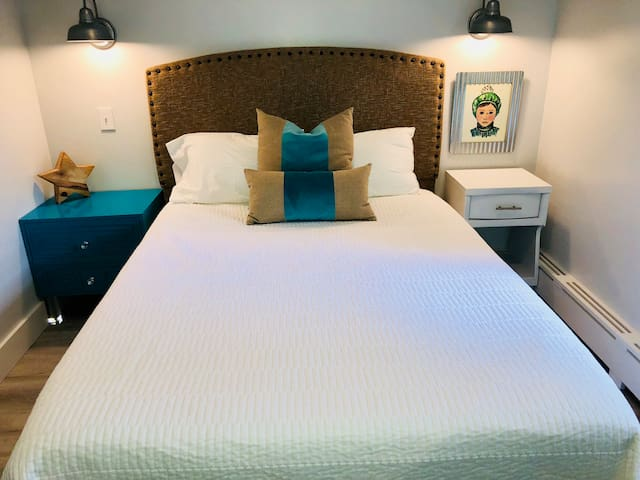 Queen Bed in downstairs bedroom.