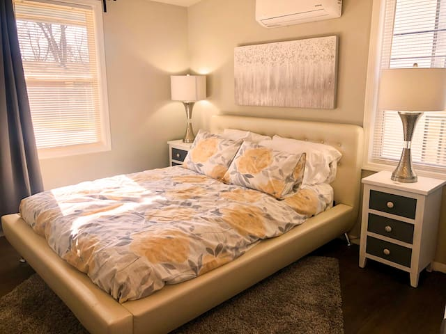 Your full sized queen bed master bedroom equipped with soft sheets and both firm and soft pillows, to ensure a full nights rest