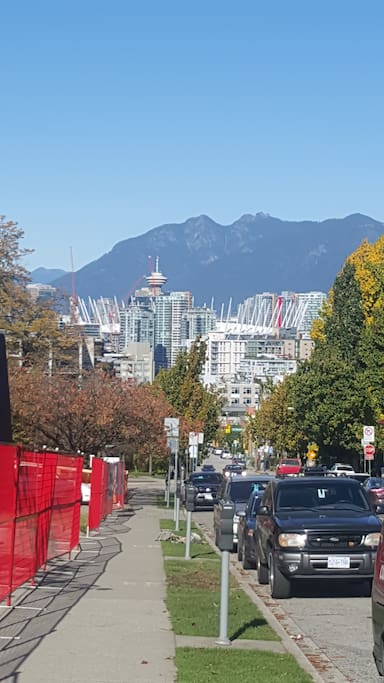 View of city skyline and north shore mountains from the corner of 12th and Yukon