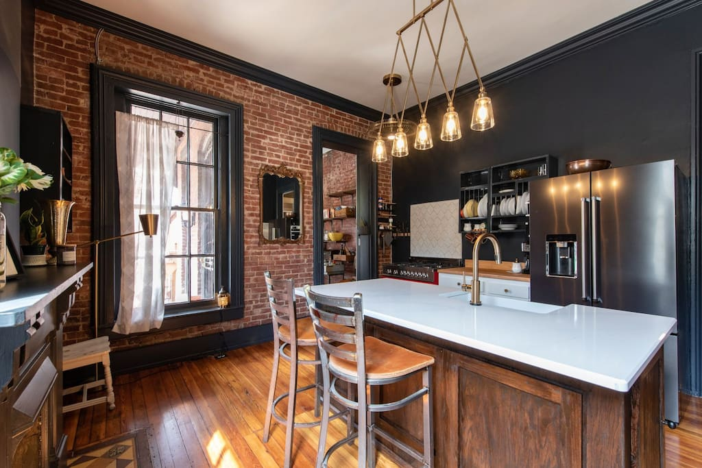The kitchen was redone in summer '18 and features original hardwood floors and a custom island