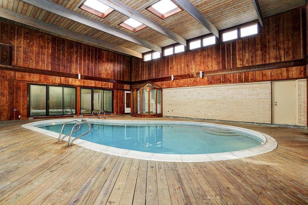 Indoor pool in the middle of the house with pool heater