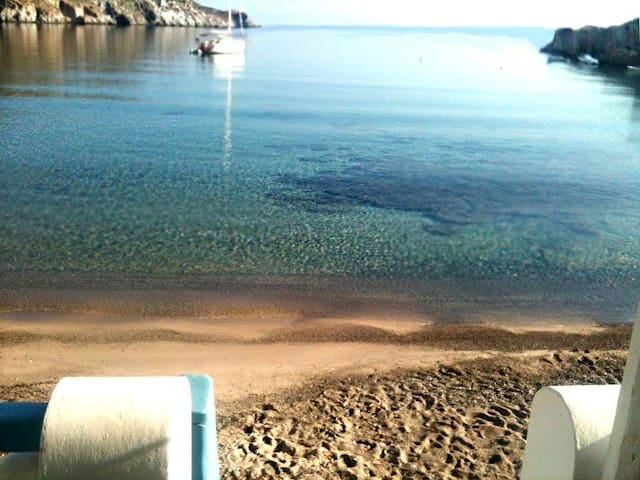 Step from your private beach studio right into the purest sea ever!