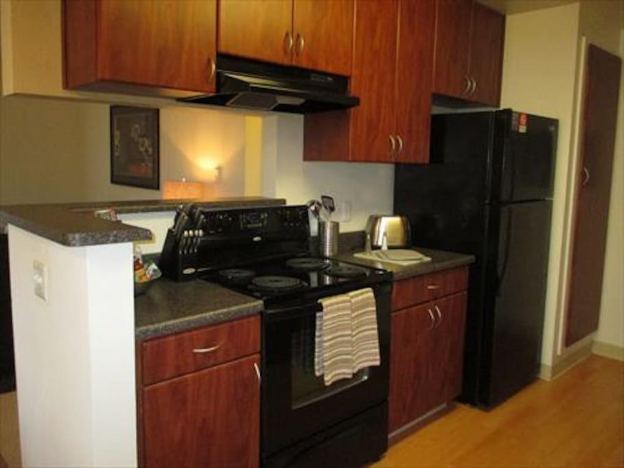 Our fully equipped kitchen offers designer cabinets, pots, pans, and utensils.