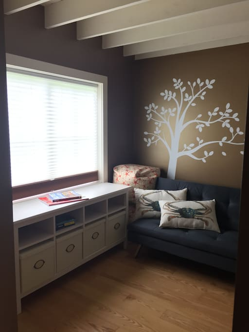 Private sitting room with Click Clack couch comfortably sleeps two children or one adult.