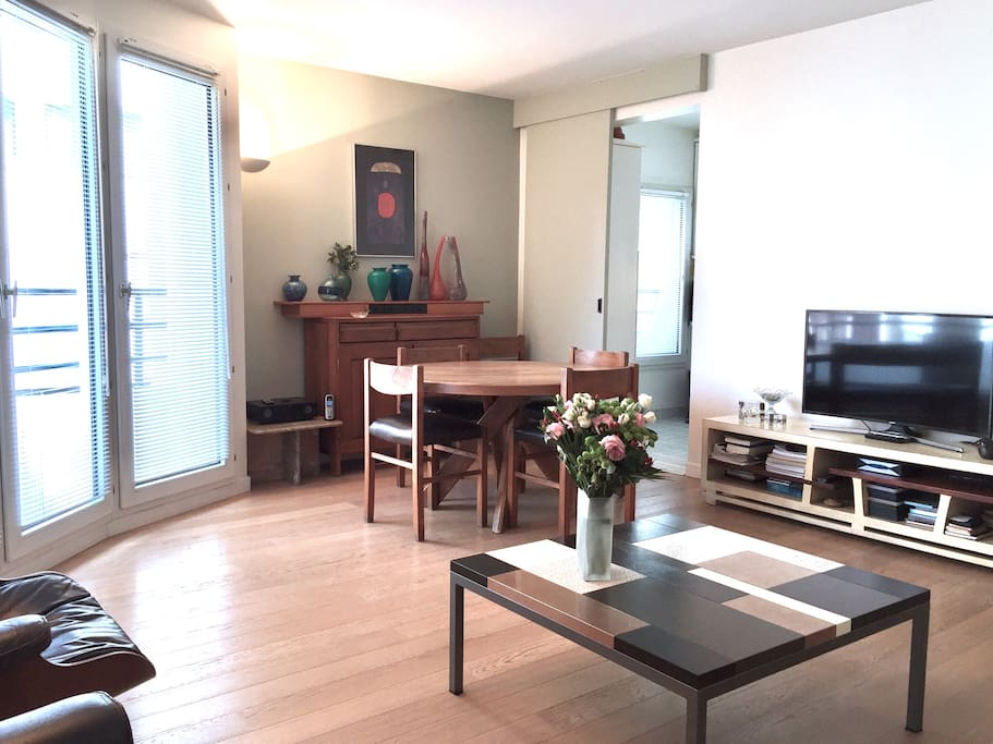 Living room / dining room, with flat screen tv and original Eames' chairs.